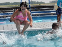 Girl Jumping into Pool during one of the camps