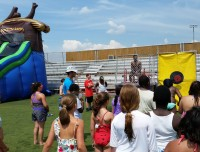 Your kids will love water slide say at Aviator summer day camps