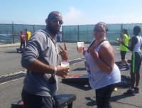 Play cornhole with friends at Aviator