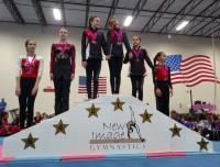 an aviator children's gymnastics team on the winners podium