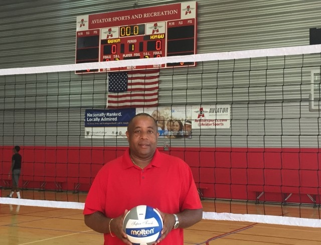 Head volleyball coach Max Auguste
