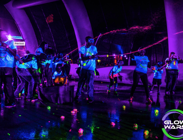 Participants get to drench the opposing team using glow soakers at the blacklight wars
