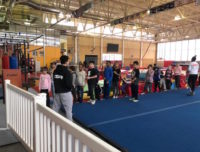 Kids ready to do gymnastics at summer vacation camp at Aviator in Brooklyn