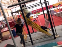 Girls do the Ninja Warrior parkour course during school recess camp