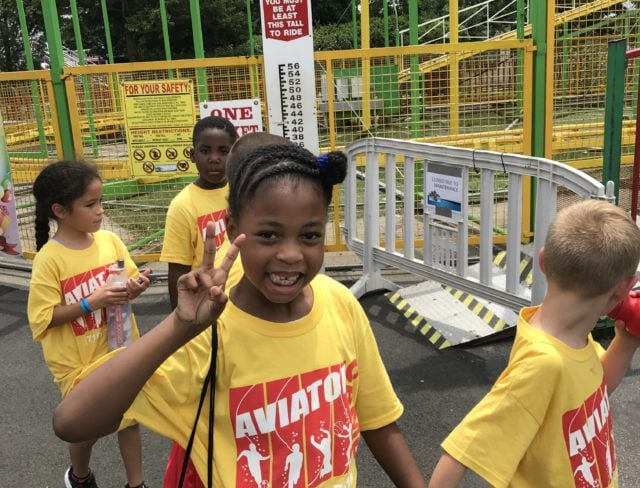 Kids from Aviator Summer Camp in Brooklyn at an amusement park on a day trip