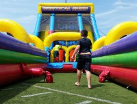 Kids at Aviator Summer Day Camp in Mill Basin play on an inflatable slide