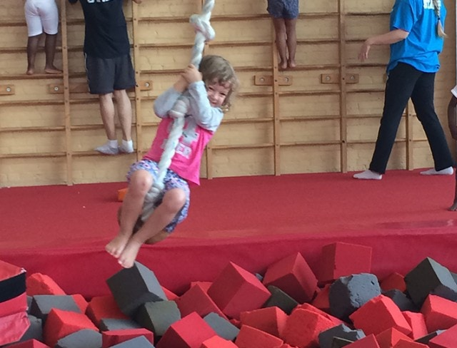 Camps swinging on the Ropes into the foam pit