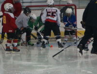 Kids play hockey at Aviator's Brooklyn summer sports camp