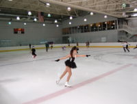 Kids learning at summer sports camp to ice skate and figure skate