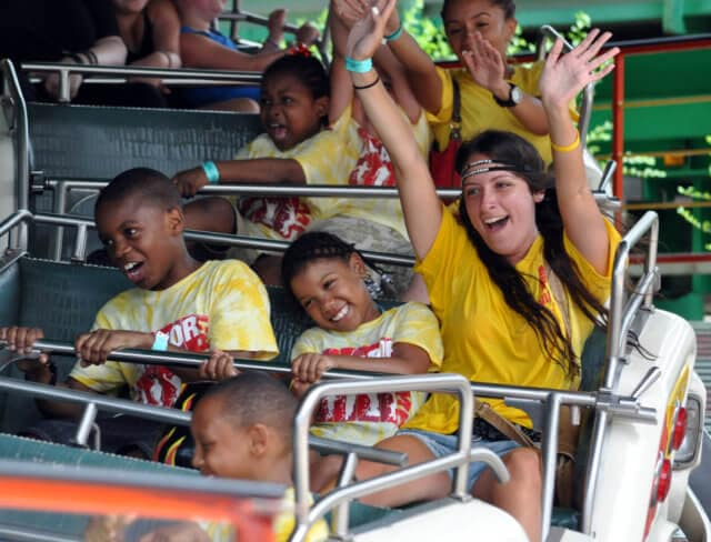 Kids and counselors on an amusement ride at Aviator summer camp