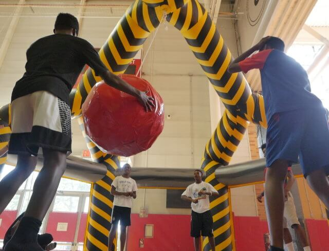 Teens play indoor tether dodgeball at summer camp at Aviator in Brooklyn