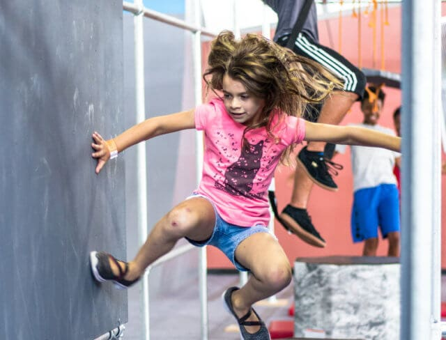 girl climbing at ninja warrior party