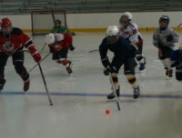 Kids playing ice hockey at Aviator's summer sports camp in Brooklyn