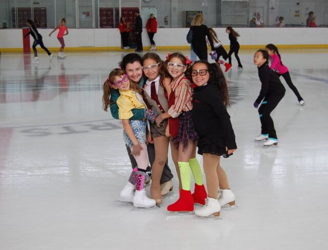 Friends at ice rink for ice skating birthday parties in Brooklyn