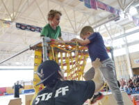 kids working together on ninja obstacle course