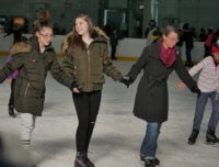 friends ice skating at a Aviator Sports Ice rink in Brooklyn