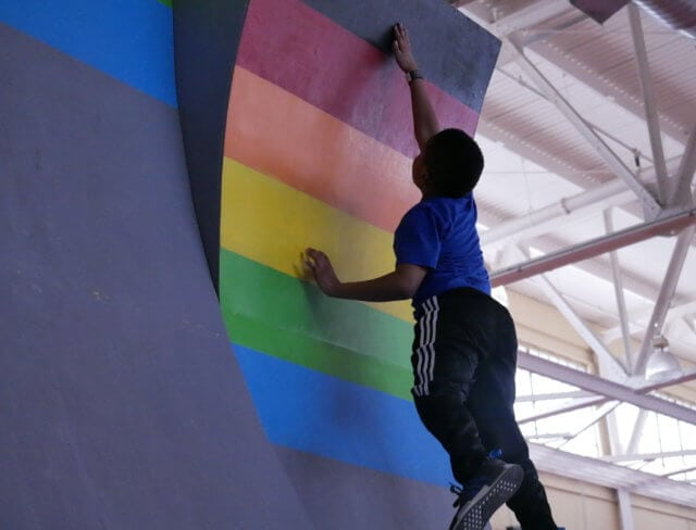 child climbing warped wall in brooklyn nyc