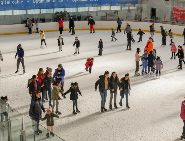 kids ice skating at a birthday party in Brooklyn New York City