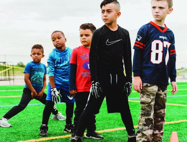 Kids during a youth flag football class
