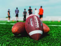Footballs on the field for Youth Flag Football classes
