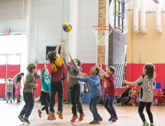 Kids play in a basketball league for kids in Brooklyn at Aviator Sports