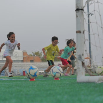 Juniors at summer camp play soccer