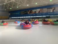 Ice bumper cars being ridden during a chancellor's Day event