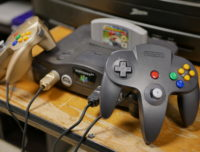 A Nintendo 64 and controller that is part of an interactive retro video game museum at a Chancellor's Day event