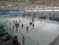 Groups ice skate indoors