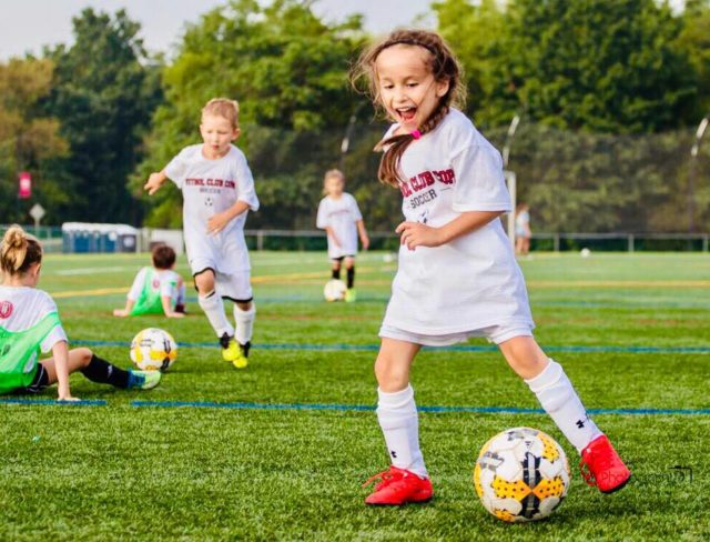 girl enjoying fc copa youth soccer camps in brooklyn