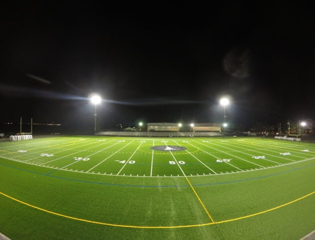 Outdoor turf field with lights at night